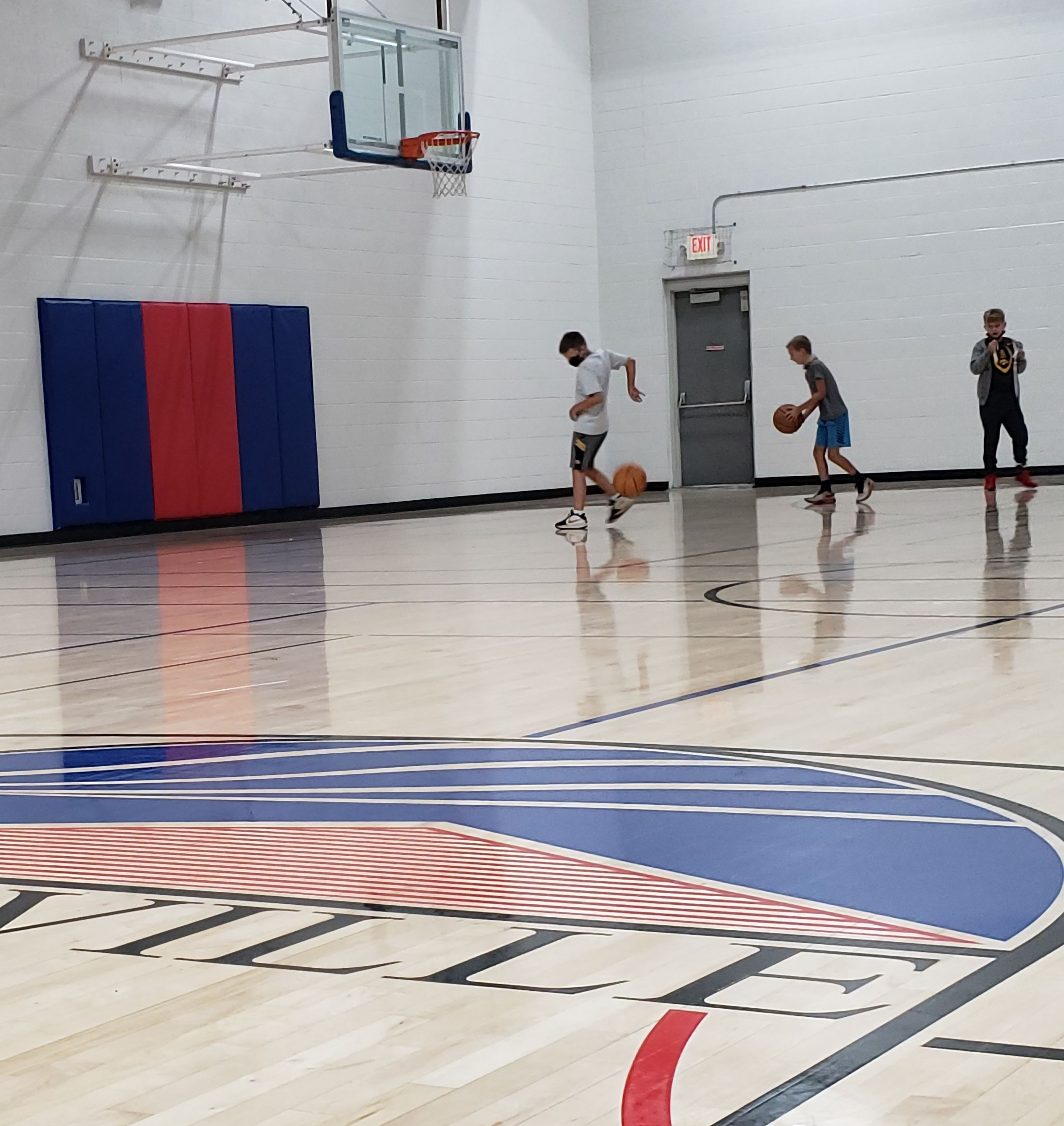 gym floor and kids in masks